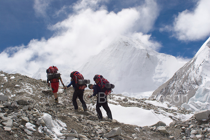 Three climbers going to camp 1 on Cho Oyu in Tibet