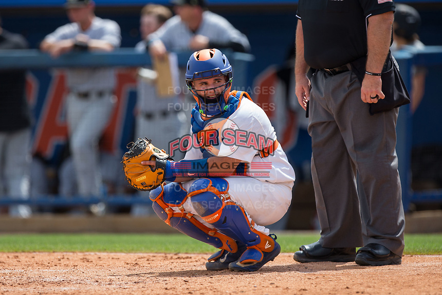 Florida Gators catcher Mike Rivera (4) looks to the dugout for the sign during the game against the Wake Forest Demon Deacons College World Series at Alfred McKethan Stadium at Perry Field on June 10, 2017 in Gainesville, Florida.  The Gators defeated the Demon Deacons 2-1 in 11 innings.  (Brian Westerholt/Four Seam Images)
