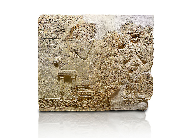 "Hittite relief sculpted orthostat stone panel  of Long Wall Limestone, Karkamıs, (Kargamıs), Carchemish (Karkemish), 900-700 BC. Anatolian Civilisations Museum.<br /> <br />  The hieroglyphics reads; ""I am Win-a-tis, beloved wife of my Lord Suhi, wherever and whenever my husband honours his name, he will honour my name as well with favours"". Underneath, there are two goddess figures, one is naked with a horned head, holding her breasts with her hands. Her genitalia is indicated by a triangle. <br /> <br /> On a White Background."