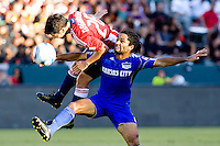 KC Wizards midfielder Stephane Auvray and Chivas USA midfielder Paulo Nagamurai battle high in the air. The Kansas City Wizards defeated CD Chivas USA 2-0 at Home Depot Center stadium in Carson, California on Sunday September 19, 2010.