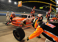 Feb 22, 2009; Fontana, CA, USA; NASCAR Sprint Cup Series driver Joey Logano pits during the Auto Club 500 at Auto Club Speedway. Mandatory Credit: Mark J. Rebilas-