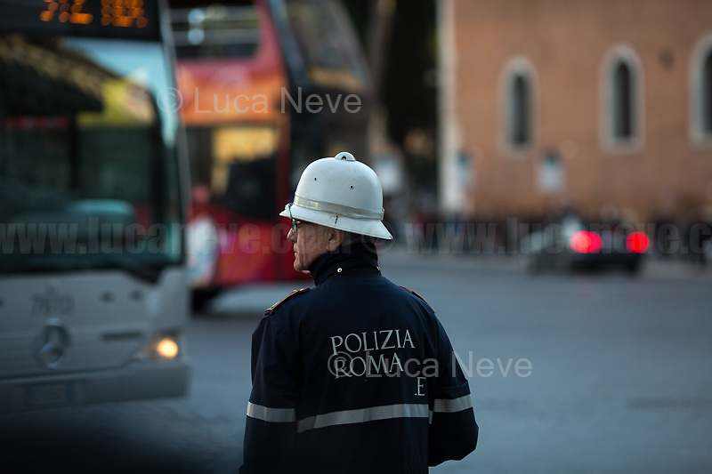 Unknown, Municipal Police Officer.<br /> <br /> Rome, 01/05/2019. This year I will not go to a MayDay Parade, I will not photograph Red flags, trade unionists, activists, thousands of members of the public marching, celebrating, chanting, fighting, marking the International Worker's Day. This year, I decided to show some of the Workers I had the chance to meet and document while at Work. This Story is dedicated to all the people who work, to all the People who are struggling to find a job, to the underpaid, to the exploited, and to the people who work in slave conditions, another way is really possible, and it is not the usual meaningless slogan: MAKE MAYDAY EVERYDAY!<br /> <br /> Happy International Workers Day, long live MayDay!