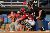 Batavia Muckdogs catcher Chad Wallach (55) and umpire Mike Savakinas during a game against the Williamsport Crosscutters on August 16, 2013 at Dwyer Stadium in Batavia, New York.  Batavia defeated Williamsport 5-2.  (Mike Janes/Four Seam Images)