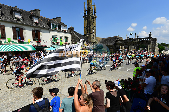 The peloton pass by during Stage 6 of the 2018 Tour de France running 181km from Brest to Mur-de-Bretagne Guerledan, France. 12th July 2018. <br /> Picture: ASO/Alex Broadway | Cyclefile<br /> All photos usage must carry mandatory copyright credit (© Cyclefile | ASO/Alex Broadway)