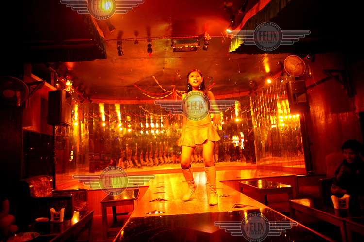 A young dancer on stage at a strip club. Most of Kathmandu's strip clubs,