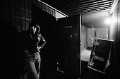 Denver, Colorado<br /> USA<br /> May 9, 1983<br /> <br /> Back stage with the Ramones lead guitarist: Johnny Ramone.<br /> <br /> The Ramones were an American rock band that formed in Forest Hills, Queens, New York in 1974, often cited as the first punk rock group. Despite achieving only limited commercial success, the band was a major influence on the punk rock movement both in the United States and the United Kingdom.<br /> <br /> All of the band members adopted pseudonyms ending with the surname &quot;Ramone&quot;, though none of them were actually related. They performed 2,263 concerts, touring virtually nonstop for 22 years. In 1996, after a tour with the Lollapalooza music festival, the band played a farewell show and disbanded.<br /> <br /> By a little more than eight years after the breakup, the band's three founding members--lead singer Joey Ramone, guitarist Johnny Ramone, and bassist Dee Dee Ramone--had all died.