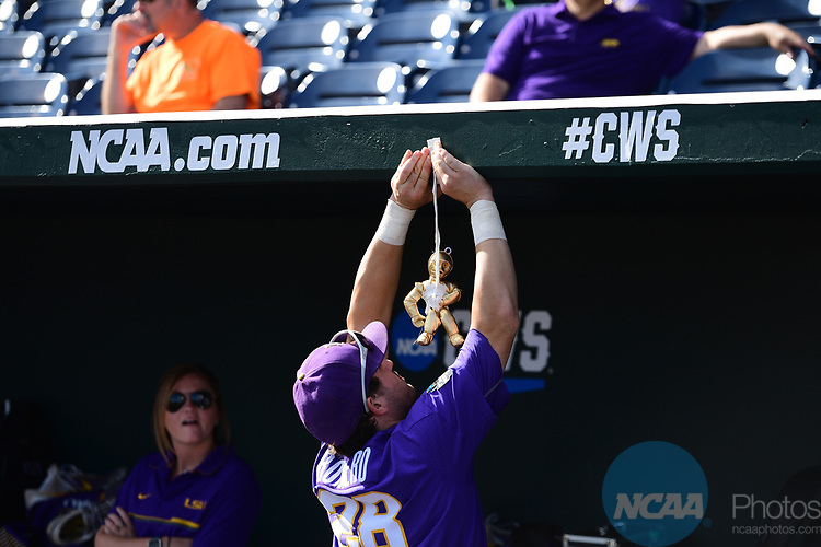 OMAHA, NE - JUNE 26: Jordan Romero (28) of Louisiana State University hangs up a toy in the dugout with tape before his team takes on the University of Florida during the Division I Men's Baseball Championship held at TD Ameritrade Park on June 26, 2017 in Omaha, Nebraska. The University of Florida defeated Louisiana State University 4-3 in game one of the best of three series. (Photo by Justin Tafoya/NCAA Photos via Getty Images)