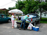 Selling sweet table corn from roadside stand