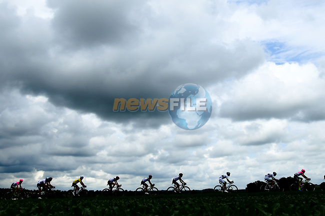 Dark clouds loom over the peleton during Stage 2 of the 2018 Criterium du Dauphine 2018 running 181km from Montbrison to Belleville, France. 5th June 2018.<br /> Picture: ASO/Alex Broadway | Cyclefile<br /> <br /> <br /> All photos usage must carry mandatory copyright credit (© Cyclefile | ASO/Alex Broadway)