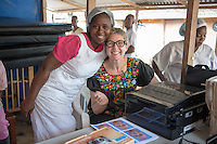 Occidental College professor Mary Beth Heffernan prints photos at the ELWA II ETU (Ebola treatment unit) in Monrovia, Liberia on Sunday, March 1, 2015. Her PPE Portrait Project involves photographing health care workers and making disposable, adhesive prints of their images, which are then placed on the worker's PPE (personal protective equipment) used to protect themselves when caring for Ebola patients.<br /> The ELWA II site has the largest number of EVD (Ebola virus disease) patients in Liberia at the moment and was the first ETU to open in Monrovia, Liberia's capital city.<br /> (Photo by Marc Campos, Occidental College Photographer) Mary Beth Heffernan, professor of art and art history at Occidental College, works in Monrovia the capital of Liberia, Africa in 2015. Professor Heffernan was there to work on her PPE (personal protective equipment) Portrait Project, which helps health care workers and patients fighting the Ebola virus disease in West Africa.<br />