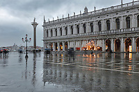 The Biblioteca Nazionale Marciana, or National Library of St Mark's, built in Renaissance style in 1537-53 by Jacopo Sansovino, then extended by Vincenzo Scamozzi in 1588, on the Piazzetta San Marco, between the Piazza San Marco and the Venetian lagoon, Venice, Italy. The 2-storey building is lined with a Doric arcade on the ground floor and Ionic arcade on the first floor, with sculptural decoration and a line of rooftop statues. The library houses an important collection of classical, Oriental and medieval codices and manuscripts. To the left is the Colonna de San Todaro, with a statue of the Byzantine saint San Teodoro Amasea, 12th century, by Nicolo Barattieri. The historical centre of Venice is listed as a UNESCO World Heritage Site. Picture by Manuel Cohen
