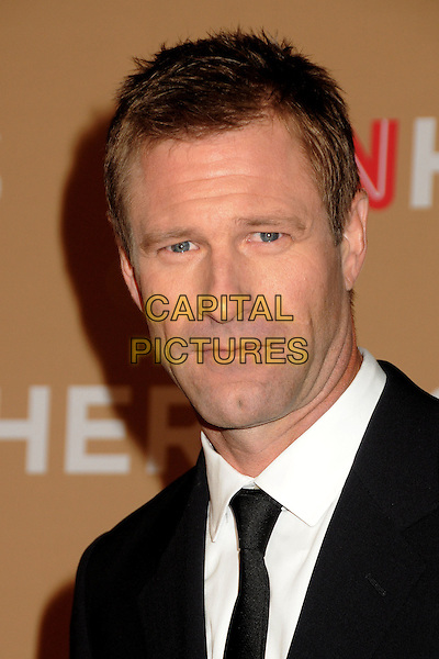AARON ECKHART .CNN Heroes: An All-Star Tribute 2010 held at the Shrine Auditorium, Los Angeles, California, USA, .20th November 2010..portrait headshot black tie white shirt .CAP/ADM/BP.©Byron Purvis/AdMedia/Capital Pictures.