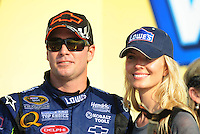 Sept. 28, 2008; Kansas City, KS, USA; Nascar Sprint Cup Series driver Jimmie Johnson celebrates with wife Chandra Johnson after winning the Camping World RV 400 at Kansas Speedway. Mandatory Credit: Mark J. Rebilas-