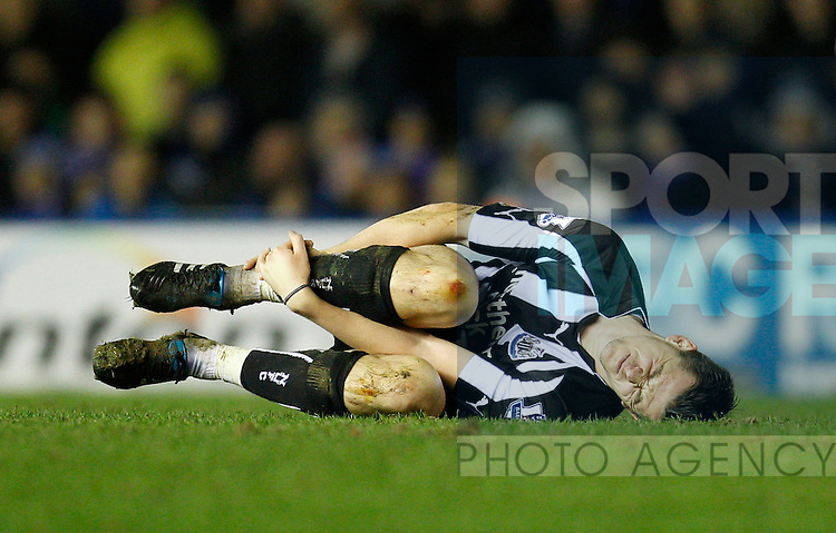 Joey Barton of Newcastle United grimaces following a foul