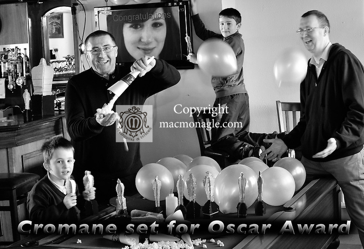 Patrick O'Reilly, left, pictured preparing to celebrate his daughter Fodhla Cronin O'Reilly nomination for an oscar  next week in Teahan's Bar in Cromane in County Kerry with publican Gerard Teahan and neighbours Darragh and Cathal Crosby..Picture by Don MacMonagle