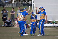 Upminster players celebrate a wicket during Upminster CC vs Essex CCC, Benefit Match Cricket at Upminster Park on 8th September 2019