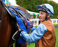 Tom Marquand unsaddles George William in the winners enclosure after winning The British Stallion Studs EBF Bathwick Tyres Conditions Stakes  during Bathwick Tyres Reduced Admission Race Day at Salisbury Racecourse on 9th October 2017