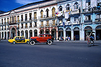 Central Havana Antique Ford, Decaying Housing, Cuba, Republic of Cuba, Laundry drying on balcony railing