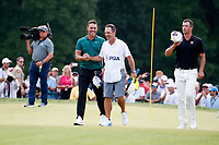 Brooks Koepka (USA) is congratulated by his caddie on the 18th green after winning the 100th PGA Championship at Bellerive Country Club, St. Louis, Missouri, USA. 8/12/2018.<br /> Picture: Golffile.ie | Brian Spurlock<br /> <br /> All photo usage must carry mandatory copyright credit (&copy; Golffile | Brian Spurlock)