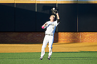 Wake Forest Demon Deacons center fielder Evan Stephens (5) catches a fly ball against the Duke Blue Devils at Wake Forest Baseball Park on April 25, 2014 in Winston-Salem, North Carolina.  The Blue Devils defeated the Demon Deacons 5-2.  (Brian Westerholt/Four Seam Images)