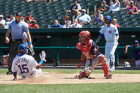 Peoria Chiefs catcher Jose Godoy (27) waits for a throw as Jose Martinez (15) slides home safely with the game winning run as umpire Andy Stukel looks on during the first game of a doubleheader against the South Bend Cubs on July 25, 2016 at Four Winds Field in South Bend, Indiana.  South Bend defeated Peoria 9-8.  (Mike Janes/Four Seam Images)