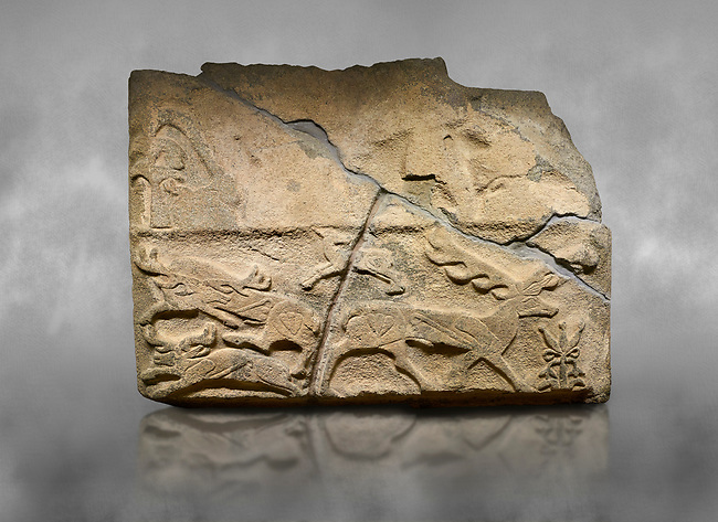 Alaca Hoyuk Hittite monumental relief sculpted orthostat stone panel. Andesite, Alaca, Corum, 1399-1301 B.C. Anatolian Civilizations Museum, Ankara, Turkey.<br /> <br /> Four deer figures are depicted in various positions with a flower in the lower right corner and a tree in the upper left corner. A faded human figure and an animal figure in the upper section are noteworthy. <br /> <br /> Against a grey art background.