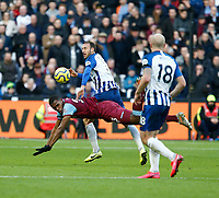 1st February 2020; London Stadium, London, England; English Premier League Football, West Ham United versus Brighton and Hove Albion; Issa Diop of West Ham United and Glenn Murray  of Brighton and Hove Albion challenge for the ball