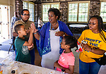 WATERBURY, CT. 13 July 2019-071319 - Waterbury NAACP Treasurer Wendy Tyson-Wood gives Donovan Degree, 8, a high five for his sundae as MaKenzie Watkis, 6, and Kayla Ireland, 16, all of Waterbury and Francisco Ramos, look on, during the NAACP's monthly meeting and Ice Cream social at Fulton Park in Waterbury on Saturday. Bill Shettle Republican-American