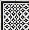 Ettienne Grand, a stone waterjet mosaic, shown in polished Calacatta and honed Nero Marquina.