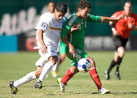 05 July 2009: Felix Zeledon of Nicaragua fights for the ball against Miguel Sabah of Mexico during the game at Oakland-Alameda County Coliseum in Oakland, California.    Mexico defeated Nicaragua, 2-0.