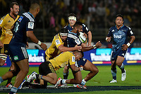 Ardie Savea ( Hurricanes ) and Lolagi Visinia ( Blues ) in action during the Super Rugby - Hurricanes v Blues at FMG Stadium, Palmerston North, New Zealand on Friday 13 March 2015. <br />