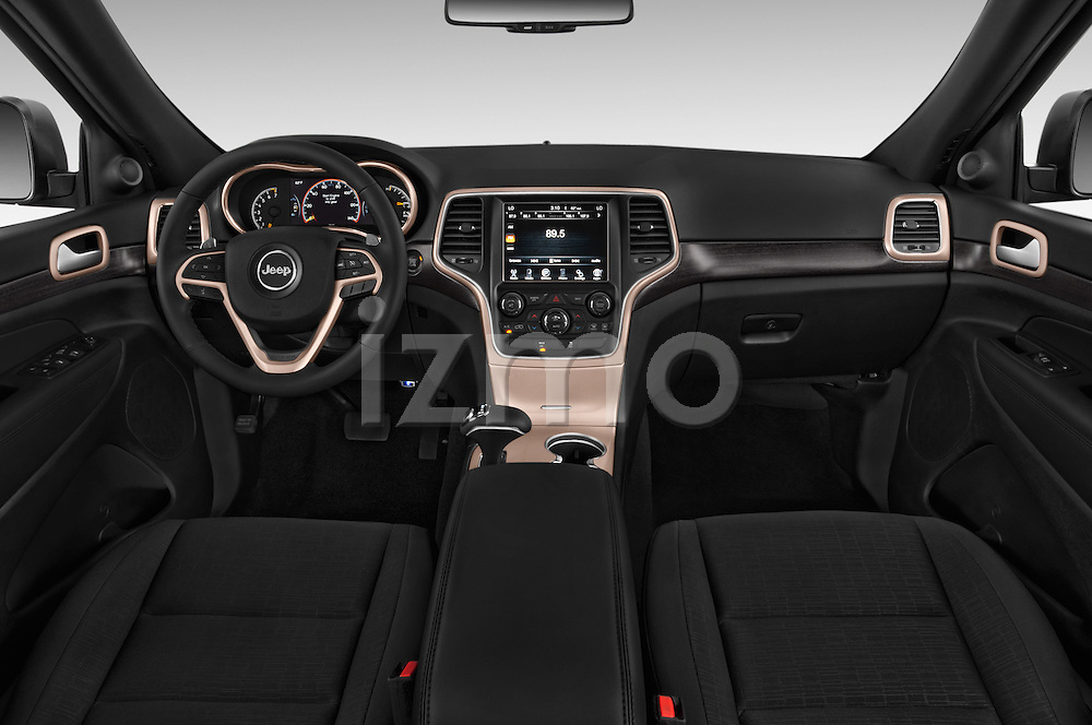 Stock photo of straight dashboard view of a 2015 Jeep Grand Cherokee Laredo 5 Door SUV