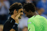 Roger Federer of Switzerland celebrates shakes hands with Gael Monfils of France after their quarter-final game at the US Open 2014 tennis tournament at the USTA Billie Jean King National Center in New York.  09.04.2014. VIEWpress