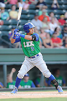 Third baseman Mauricio Ramos (3) of the Lexington Legends bats in a game against the Greenville Drive on Friday, August 29, 2014, at Fluor Field at the West End in Greenville, South Carolina. Greenville won, 6-1. (Tom Priddy/Four Seam Images)