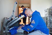 Lagos, Portugal - March 2, 2015:   USWNT managers print names and numbers on the newest Nike jersey in preparation for the Algarve Cup in Lagos, Portugal.
