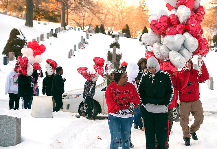 WATERBURY, CT 020714JS11- FEBRUARY 11, 2014_ Tamara Dawkins of Naugatuck, front left, along with family and friends, held a graveside vigil at All Saints Cemetery in Waterbury on Tuesday for her son Torrance Dawkins, who was killed outside a nightclub in New Haven in August. Tamara is frustrated because no arrests have been made six months after the shooting. Jim Shannon Republican-American