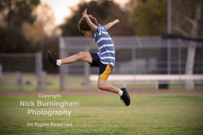 Carefree boy leaps into the air at the park - EXCLUSIVELY AVAILABLE HERE