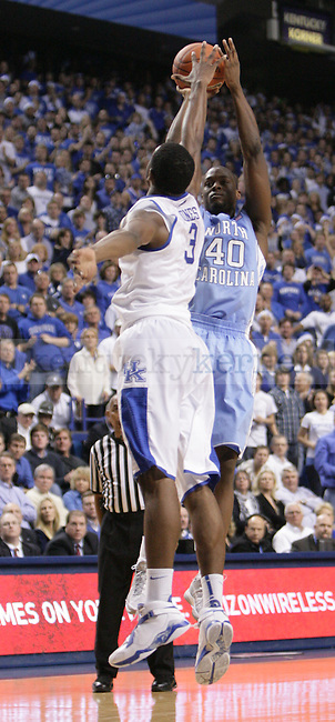 UK forward Terrence Jones attempts to block a shot by North Carolina forward Harrison Barnes during the first half of UK's home game against North Carolina at Rupp Arena in Lexington, Ky., Dec. 1, 2011. Photo by Brandon Goodwin