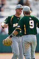 Baylor Bears third baseman Cal Towey #18 celebrates with teammate Max Muncy #9 after the NCAA Regional baseball game against Oral Roberts University on June 3, 2012 at Baylor Ball Park in Waco, Texas. Baylor defeated Oral Roberts 5-2. (Andrew Woolley/Four Seam Images)