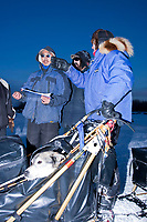 Linwood Fiedler checks into Nikolai with his dog *Prozac* in the basket during the 2010 Iditarod
