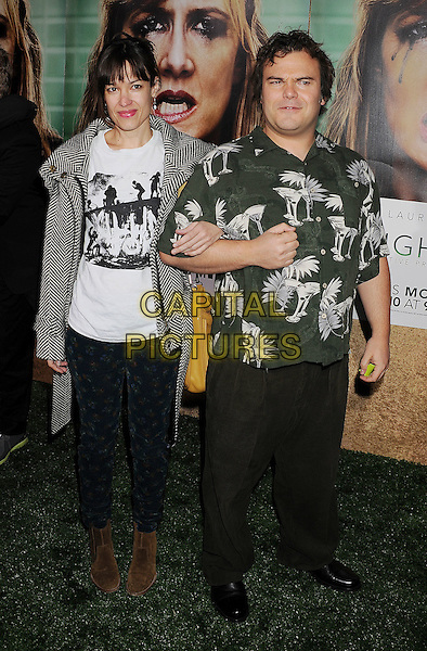 """Tanya Haden & Jack Black.arriving at the Los Angeles Premiere of HBO's """"Enlightened"""" at Paramount Theater on the Paramount Studios backlot in Hollywood, California on October 6th, 2011..full length married couple husband wife jeans white t-shirt  print brown suede boots  green white print shirt .CAP/ROT/TM.©TM/Rothstock/Capital Pictures"""