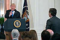 United States President Donald J. Trump responds to a question from CNN White House correspondent Jim Acosta as he holds a press conference in the East Room of the White House in Washington, DC on Wednesday, November 7, 2018.<br />