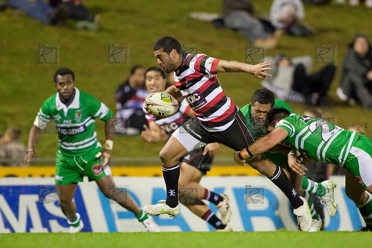 Siale Piutau breaks out of the attempted tackle by Johnny Leota and Francis Bryant. ITM Cup Championship Division Round 2 rugby game between Counties Manukau Steelers and Manawatu, played at Bayer Growers Stadium Pukekohe, on Wednesday July 20th 2011. Counties Manukau won the game 32 - 25 after leading 19 - 18 at halftime.