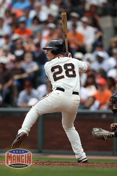 SAN FRANCISCO - MAY 31:  Buster Posey #28 of the San Francisco Giants bats against the Colorado Rockies during the game at AT&T Park on May 31, 2010 in San Francisco, California. Photo by Brad Mangin