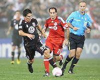 Jaime Moreno #99 of D.C. United pulls away from Nick LaBrocca #21 of Toronto FC during an MLS match that was the final appearance of D.C. United's Jaime Moreno at RFK Stadium, in Washington D.C. on October 23, 2010. Toronto won 3-2.