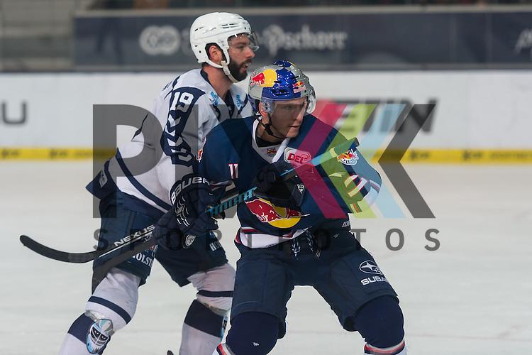Eishockey, DEL, EHC Red Bull M&uuml;nchen - Hamburg Freezers <br /> <br /> Im Bild Philippe DUPUIS (Hamburg Freezers, 19), Keith AUCOIN (EHC Red Bull M&uuml;nchen, 11) beim Spiel in der DEL EHC Red Bull Muenchen - Hamburg Freezers.<br /> <br /> Foto &copy; PIX-Sportfotos *** Foto ist honorarpflichtig! *** Auf Anfrage in hoeherer Qualitaet/Aufloesung. Belegexemplar erbeten. Veroeffentlichung ausschliesslich fuer journalistisch-publizistische Zwecke. For editorial use only.