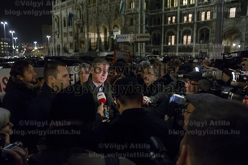 Ferenc Gyurcsany former Pime Minister of Hungary, leader of opposition group Democratic Coalition talks to press in front of demonstrators who form a human chain around Parliament to protest election law changes in Budapest, Hungary on November 19, 2012. ATTILA VOLGYI
