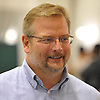 Mike Maccagnan, New York Jets general manager, speaks to a reporter after a day of team training camp at Atlantic Health Jets Training Center in Florham Park, NJ on Saturday, July 30, 2016.