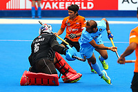 Ramandeep Singh scores the first of India's goals during the Hockey World League Quarter-Final match between India and Malaysia at the Olympic Park, London, England on 22 June 2017. Photo by Steve McCarthy.