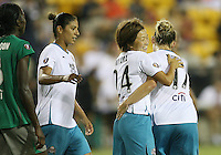 Cristiane #78, Aya Miyama #24 and Amy Rodriguez #17 of Marta's XI after Amy Rodriguez #17 had scored during the WPS All-Star game against Abby's XI at the KSU Stadium in Kennesaw, Georgia on June 30 2010. Marta XI won 5-2.